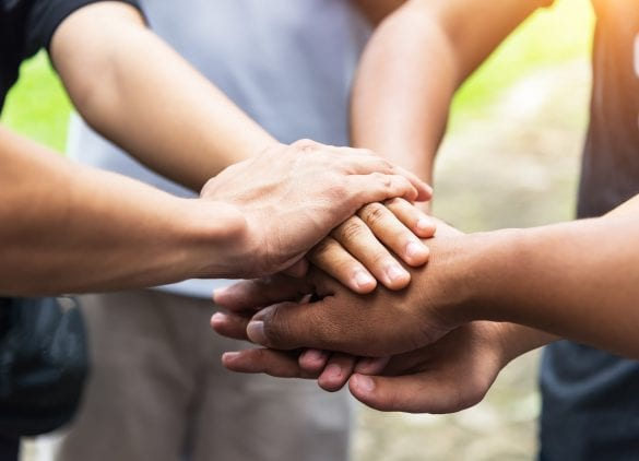 Hands of patients joining in together