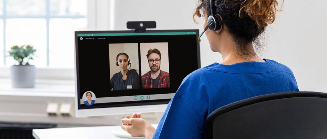 A healthcare professional in a multi-party video consultation