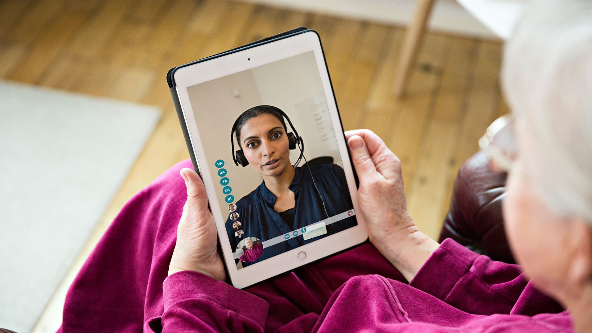 Older woman participates in group video consultation